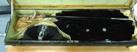 A DRESS SWORD, contained within a tin case.