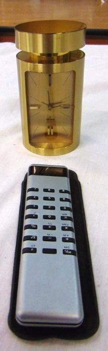 A 1970'S SINCLAIR CALCULATOR, together with a brass