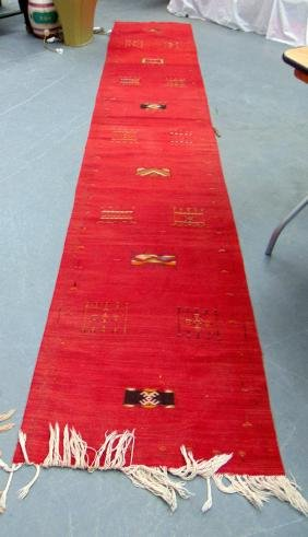 A RED PERSIAN RUNNER, decorated. 12 ft x 2 ft 5ins.