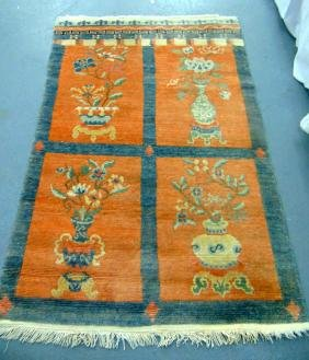 AN ART DECO CHINESE RUG, decorated with precious