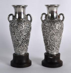 A PAIR OF LATE 19TH CENTURY CHINESE EXPORT SILVER VASES