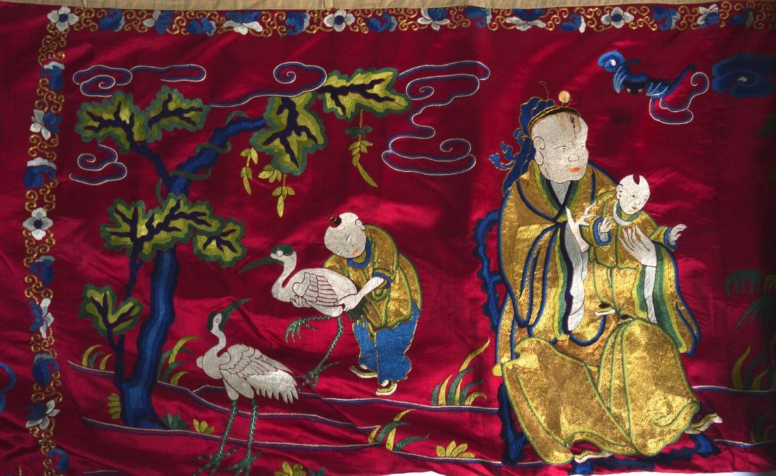 A LATE 19TH CENTURY CHINESE RED SILKWORK PANEL