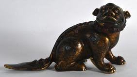 A CHINESE ENAMELLED BRONZE FIGURE OF A BUDDHISTIC BEAST