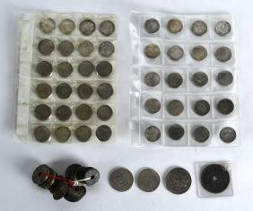 A COLLECTION OF VARIOUS CHINESE COINS in various forms.
