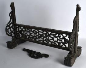 A 19TH CENTURY CHINESE CARVED HARDWOOD SCREEN probably