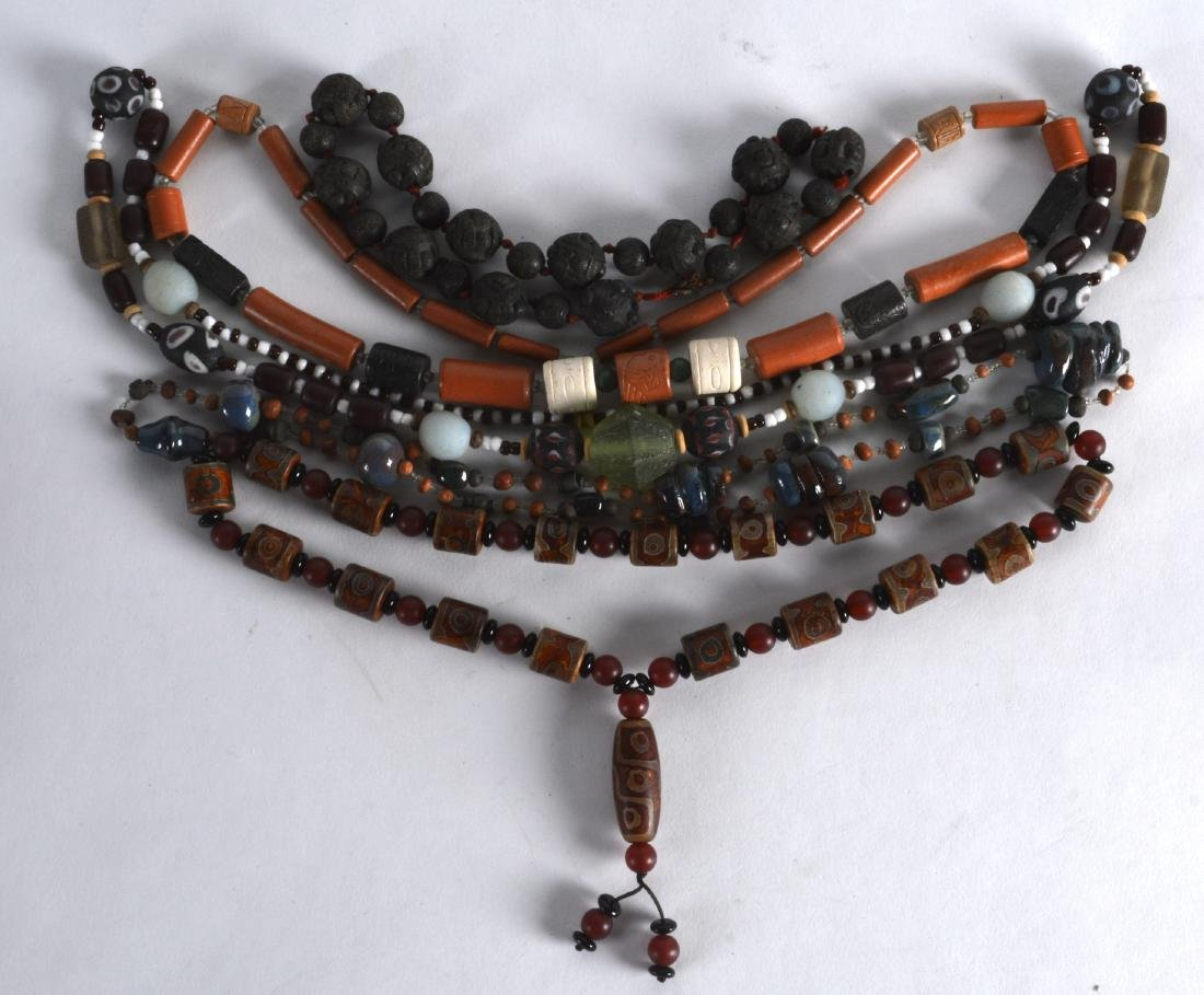 A GROUP OF TIBETAN CHINESE AND OTHER CARVED NECKLACES