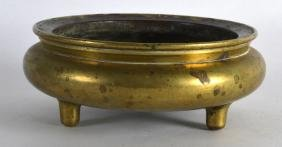 A CHINESE QING DYNASTY BRONZE SHALLOW CENSER supported
