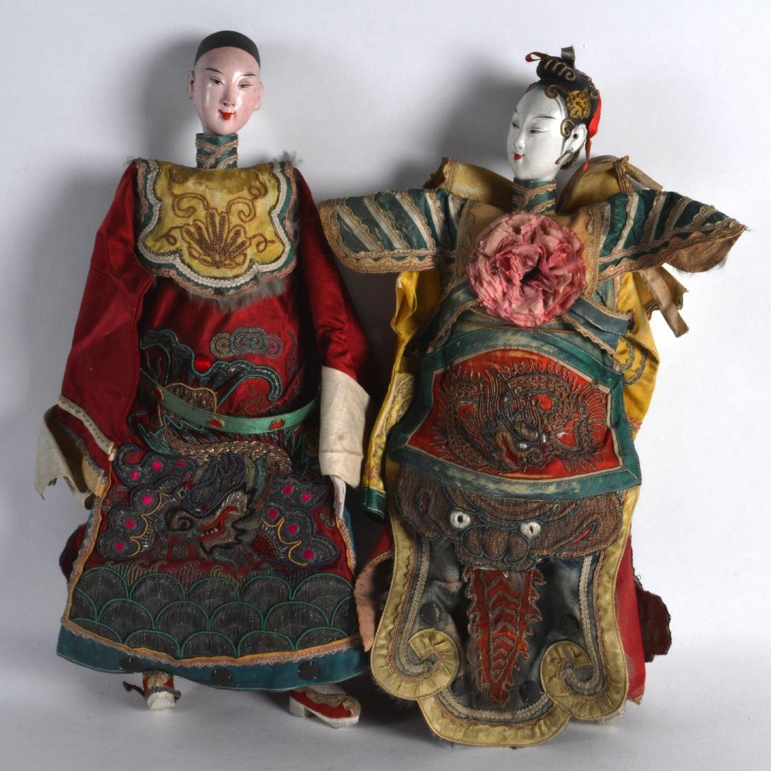 A PAIR OF EARLY 20TH CENTURY CHINESE SILKWORK DOLLS