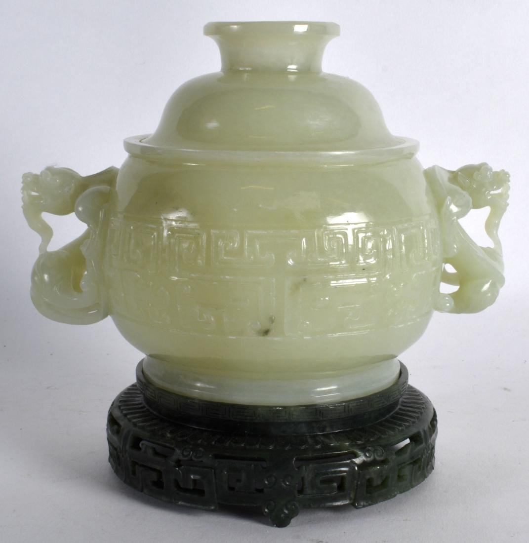 A CHINESE CARVED GREEN JADE TWIN HANDLED CENSER AND