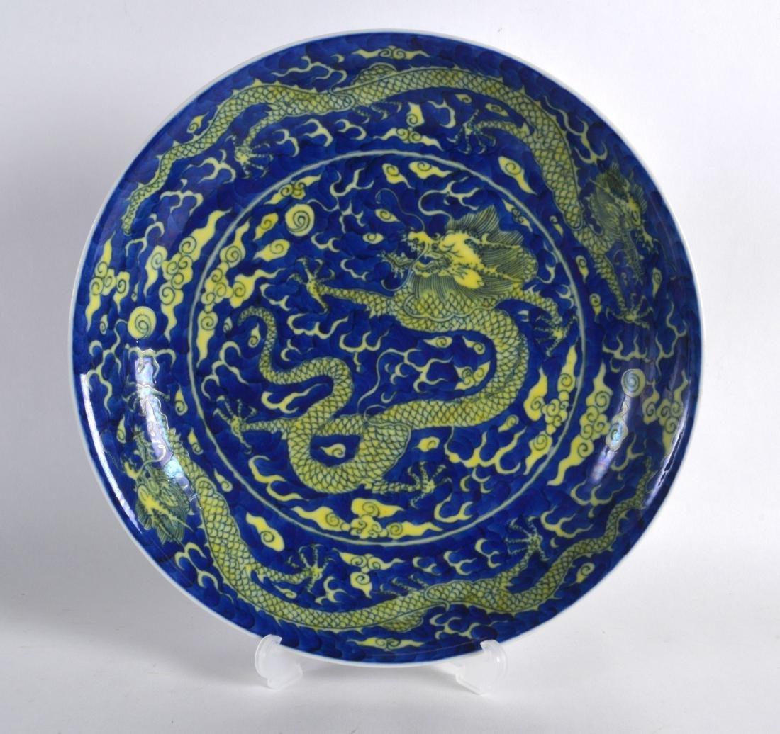 A CHINESE YELLOW AND BLUE GROUND CIRCULAR DISH bearing