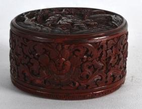 A SMALL 18TH CENTURY CHINESE CARVED CINNABAR LACQUER
