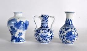 THREE CHINESE BLUE AND WHITE VASES 20th Century. (3)