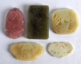 A GROUP OF FOUR CHINESE CARVED JADE ARTICLES together