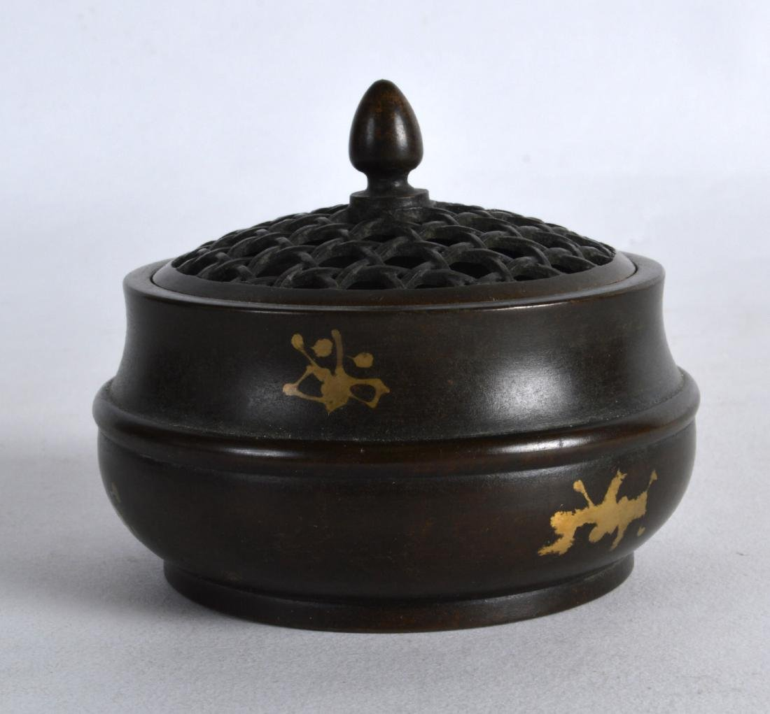 A CHINESE GOLD SPLASH BRONZE CENSER AND COVER bearing