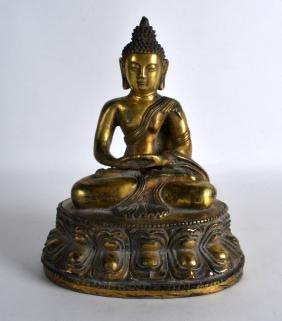 A SINO TIBETAN BRONZE FIGURE OF A BUDDHA modelled upon
