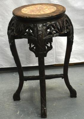 A 19TH CENTURY CHINESE MARBLE INSET HARDWOOD STAND. 2Ft