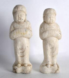 A PAIR OF EARLY CHINESE CARVED MARBLE TOMB FIGURES.