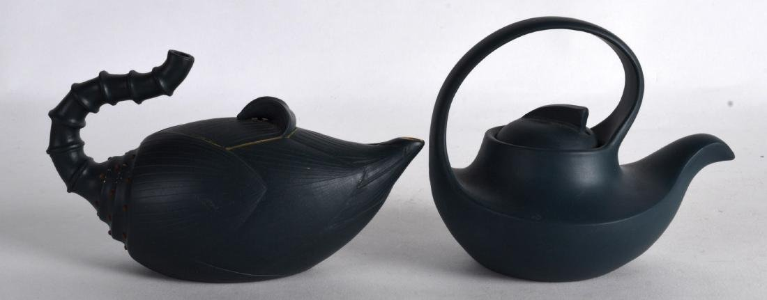 TWO CHINESE YIXING POTTERY BLUE TEAPOTS AND COVERS.