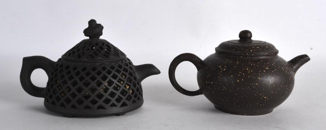 TWO CHINESE YIXING POTTERY BROWN TEAPOTS AND COVERS one