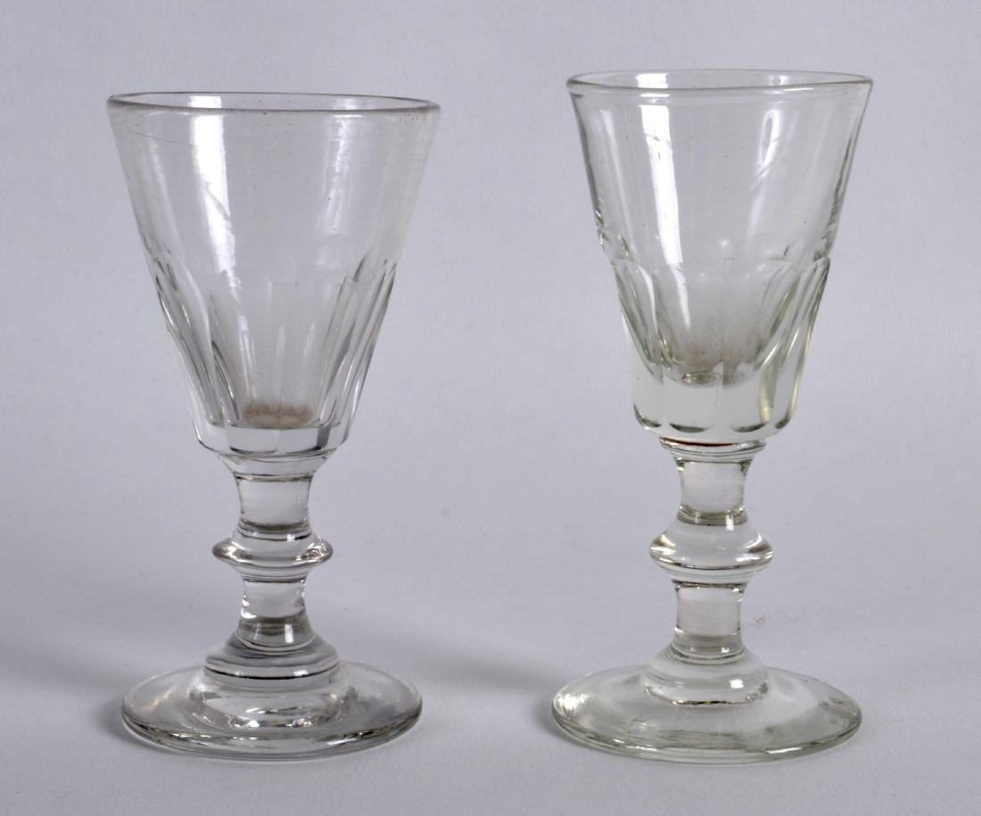 A MATCHED PAIR OF ANTIQUE GLASSES. 3.25ins high.