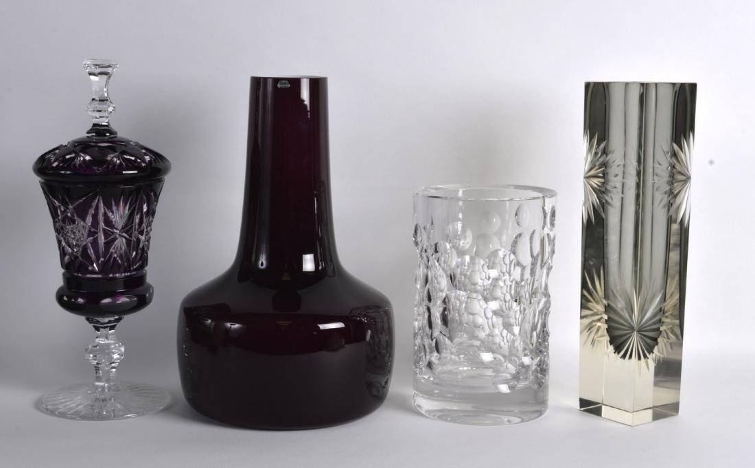 A BOHEMIAN PUCE GLASS VASE AND COVER together with a