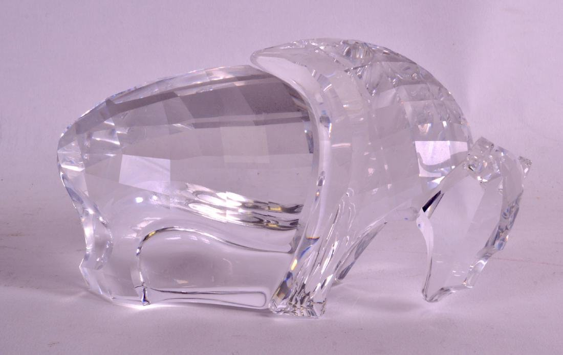 A BOXED SWAROVSKI FIGURE OF A BUFFALO with blank stand.
