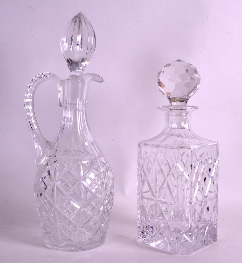 TWO GLASS DECANTERS AND STOPPERS. 1Ft 1ins & 1ft 10ins