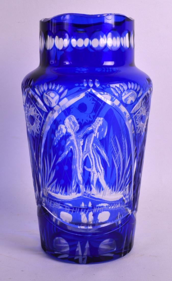 AN UNUSUAL BOHEMIAN BLUE FLASH GLASS VASE decorated