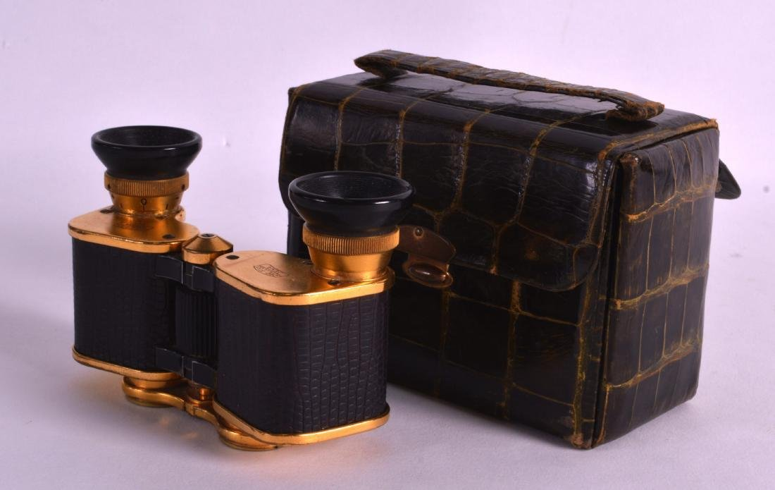 A PAIR OF VINTAGE CARL ZEISS BINOCULARS within a croc