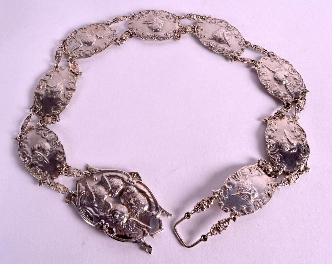 A LOVELY ART NOUVEAU SILVER BELT by William Comyns.
