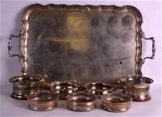 A LARGE ANTIQUE TWIN HANDLED SILVER TRAY together with