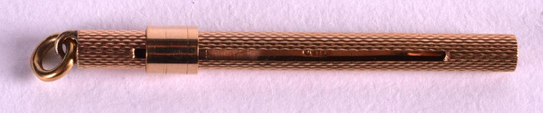 AN EDWARDIAN 9CT GOLD PUSH-OUT TOOTH PICK by