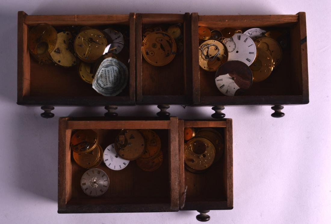 A MINIATURE CHEST OF DRAWERS containing numerous clock - 2