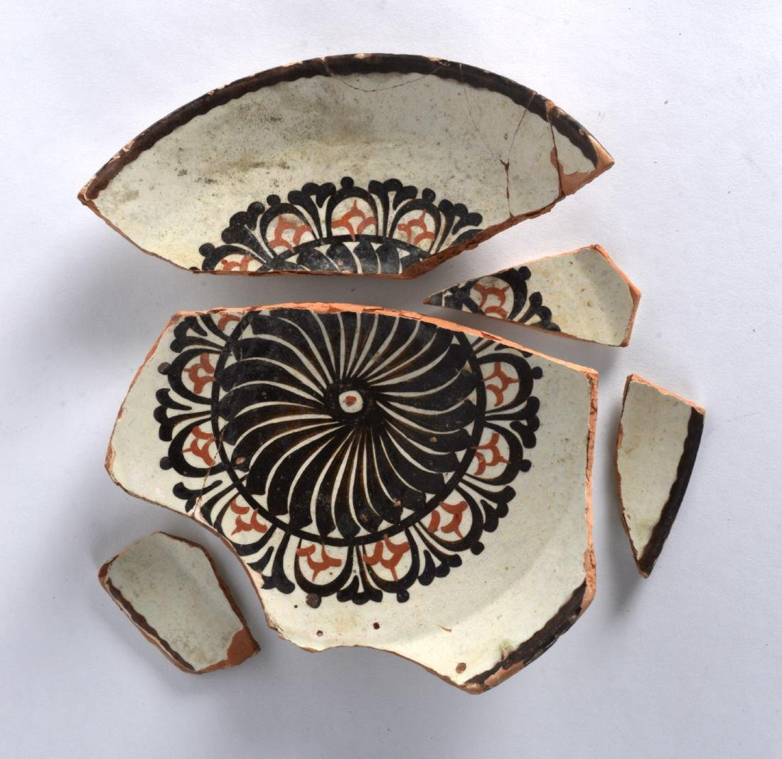 A Persian Cream Ground Nishapur Plate, 9th/10th