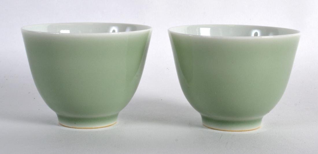 A PAIR OF CHINESE CELADON TEABOWLS bearing Qianlong
