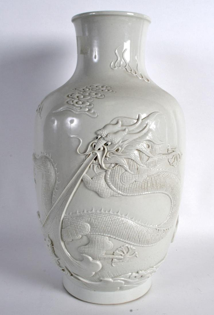 A CHINESE BLANC DE CHINE PORCELAIN VASE decorated in