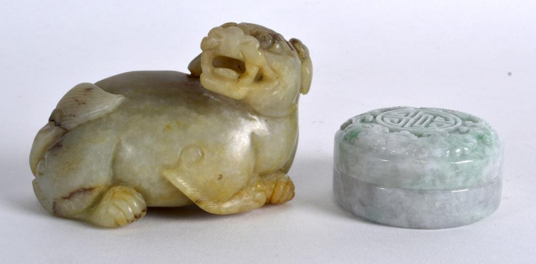 A CHINESE CARVED JADE FIGURE OF A RECUMBANT BEAST