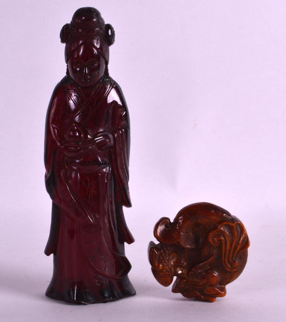 AN EARLY 20TH CENTURY CHINESE CARVED RED AMBER FIGURE