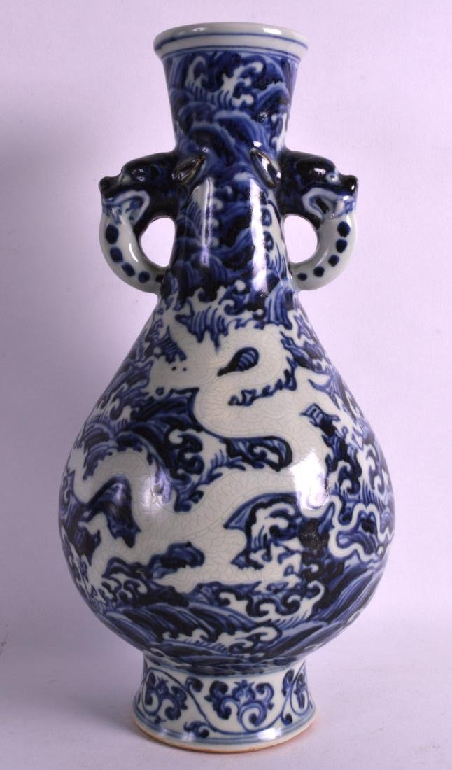 A CHINESE BLUE AND WHITE TWIN HANDLED VASE bearing