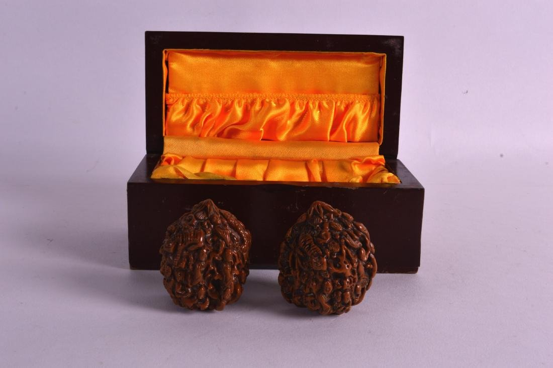 A PAIR OF EARLY 20TH CENTURY CHINESE CARVED NUTS formed