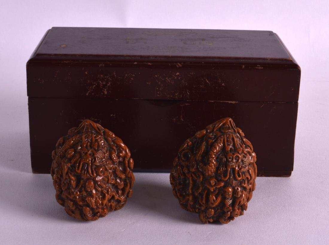 A PAIR OF EARLY 20TH CENTURY CHINESE CARVED NUTS formed - 2