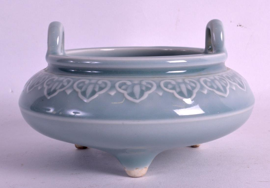 A CHINESE TWIN HANDLED PORCELAIN CENSER bearing