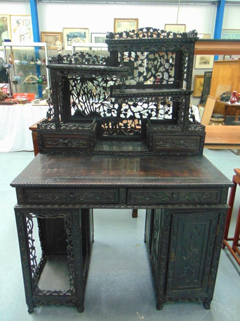 A GOOD 19TH CENTURY CHINESE HONGMU DESK with shelving,