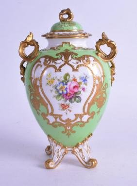 ROYAL CROWN DERBY VASE & COVER, painted on green ground