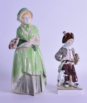 A GERMAN PORCELAIN FIGURE OF A BOY modelled beside a