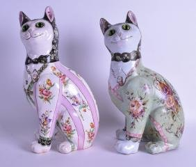 A PAIR OF FAIENCE GLAZED POTTERY FIGURES OF CATS