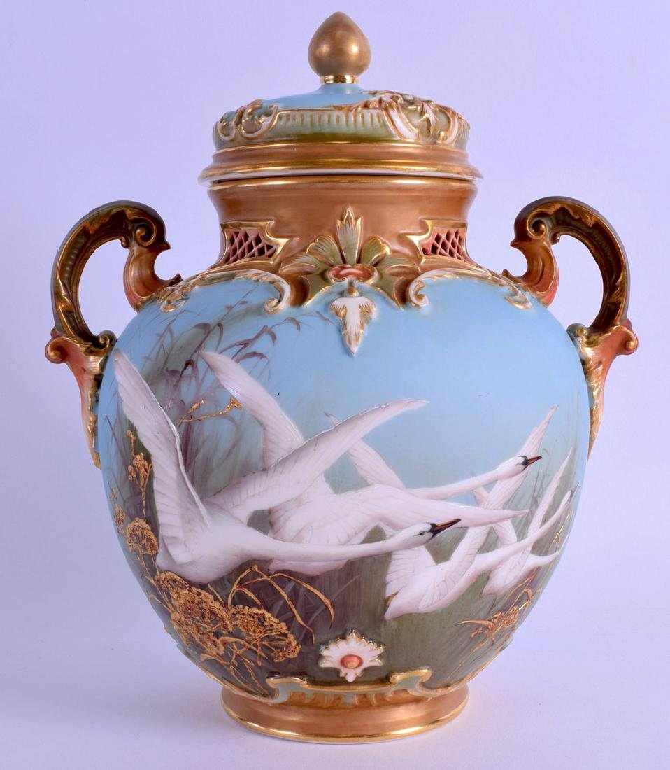 A FINE ROYAL WORCESTER TWIN HANDLED VASE AND COVER