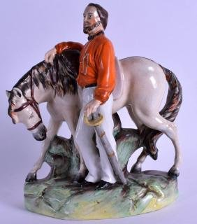 A 19TH CENTURY STAFFORDSHIRE POTTERY FIGURE OF