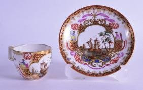 A MINIATURE 19TH CENTURY MEISSEN PORCELAIN TEACUP AND