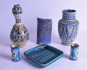 A 19TH CENTURY SPANISH FAIENCE GLAZED WATER GUGLET
